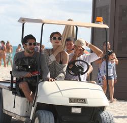 http://img282.imagevenue.com/loc344/th_312769179_Mischa_Barton_Bikini_Candids_on_the_Beach_in_Miami_December_27_2011_245_122_344lo.jpg