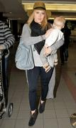 http://img282.imagevenue.com/loc582/th_177113638_Hilary_Duff_arriving_at_LAX9_122_582lo.jpg